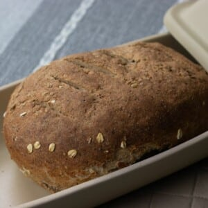 whole wheat bread in covered bread pan